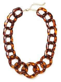 Indulge in the tony, Uptown allure of this stunning statement necklace. It features chunky tortoise shell links for a look that's Jackie O-glamorous.