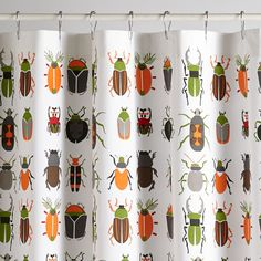 This exclusively designed shower curtain features a cascade of brightly illustrated bugs, adding a bit of entomological charm to any bathroom in your home.