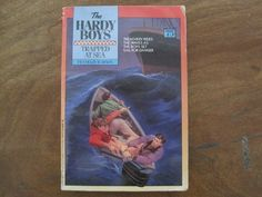 Trapped at Sea (The Hardy Boys, Book 75) by Franklin W. Dixon http://www.amazon.com/dp/0671423630/ref=cm_sw_r_pi_dp_acBOvb11JH4AS