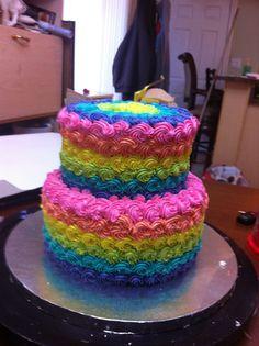 Rainbow pink orange blue yellow cake