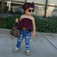 Leopard booties, ripped jeans and LV. Headband is cute, too!