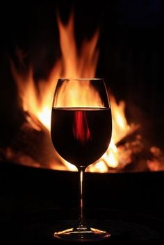Glass of wine and a fire