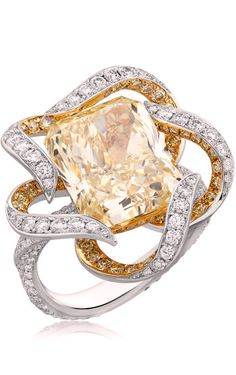 Nirav Modi ring featuring a fancy yellow radiant-cut solitaire, surrounded by a delicate ribbon of fancy yellow and white diamonds