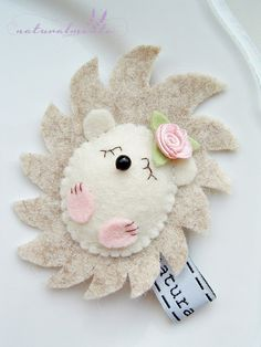 This hedgehog is a colorful handmade wool felt doll. This is little brooch. Not toy, the hedgehog is not recommend for children under 3.