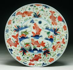 """A Chinese Famille Verte Porcelain Plate: signed with 'Kangxi' mark on the base; Size: D: 8-1/4"""""""