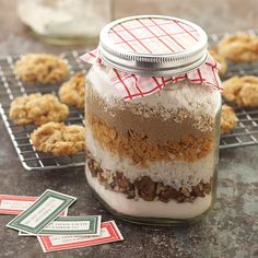 Layered Cookie Ingredients Jar. Layer the ingredients for our delicious Coconut Crunch Cookies in a quart jar and fasten the lid with a holiday-pattern napkin for presentation. Include the recipe and easy baking instructions on a card, and tie on with a festive ribbon for an oh-so-sweet holiday hostess gift.