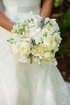 The bridal bouquet will be a clutch of cream hydrangeas, ivory lisianthus, white sweetpeas, ivory spray roses, and grey dusty miller wrapped in ivory linen.
