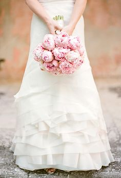 love the asymmetric ruffles on this wedding dress - goes so well with peony petals