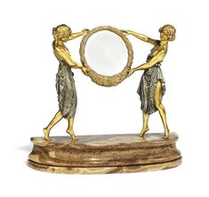A FRENCH 'ART NOUVEAU' GILT AND SILVERED-BRONZE FIGURAL MIRROR  BY R. GILBERT, EARLY 20TH CENTURY.