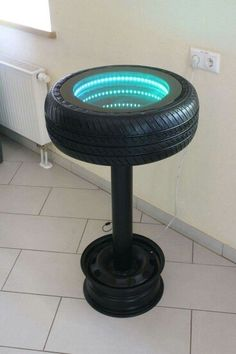 Tire, rim & some LED lights makes a bar table.