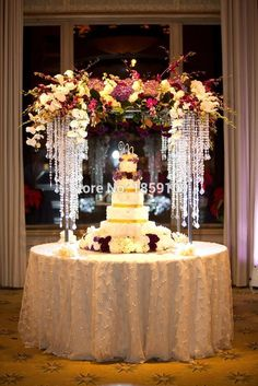 Glamorous Wedding Cake Table Ideas for Spectacular Wedding Decor- A young man and young woman will be so busy to prepare their big day, wedding. There are numerous things to prepare before a wedding including the sui. Wedding Table Flowers, Wedding Table Centerpieces, Wedding Decorations, Flower Table, Cake Tables For Weddings, Tall Flower Centerpieces, Quince Centerpieces, Crystal Centerpieces, Table Wedding