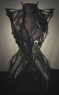 Wet formed leather + metallic thread + mesh + satin coutil corset bodysuit by Cristiane Tano.