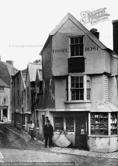 Lyme Regis, The Old Fossil Shop c.1891. The remarkable Miss Mary Anning brought fame to Lyme when she discovered an ichthyosaur near Charmouth in 1811. Fossil hunting remains a lucrative industry here to this day. This fossil shop, the first such outlet in the town, was demolished when the road was widened in 1913.