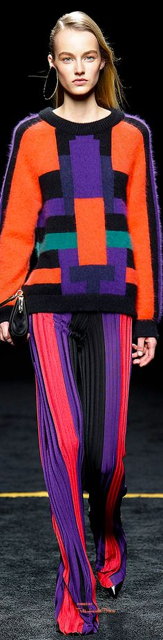 Balmain Fall 2015 RTW. The 80's used a lot of bold, primary colors and geometric motifs, so this sweater looks very 80's. There was a lot of futurism as well, and we are still being inspired by futurism today.
