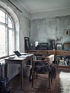 How cozy is this office area? The window view and purposely worn walls are oh-so perfect!