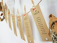 8 Rustic Hanging Seating Plan Cards - Kraftpaper with natural pegs and red love hearts
