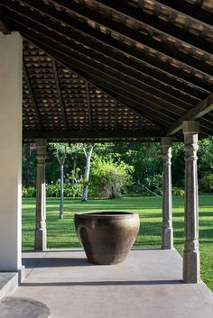 Sea change: renovating a Sri Lanka retreat A large Chinese urn bought from Paradise Road Design Warehouse, Colombo, sits on the verandah of the ambalama. British Colonial Style, French Colonial, Village House Design, Village Houses, Tropical Architecture, Architecture Design, Sri Lankan Architecture, India House, Modern Cafe