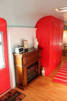 Craft Trailer, My 1960 Streamline travel trailer turned stationary CRAFT TRAILER STUDIO!, Electric fireplace for heating. Tall red closet st...