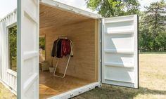 Needs & Wants Studios and Marco Lee transformed a shipping container into a beautiful and welcoming timber-lined showroom.