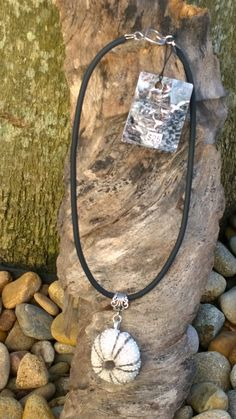 Small sea urchin necklace highlighted in grey under glaze. by simonesceramics on Etsy