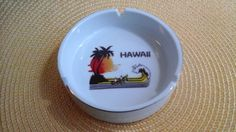 Found a vintage Hawaii souvenir ashtray with this image, but on a long, rectangular shaped tray with a fake wood painted edge.  Really kitchy tiki room swag!