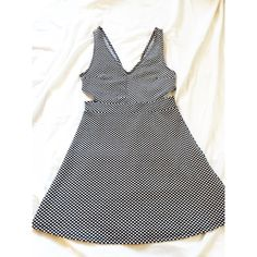 New listing Navy blue polka dot dress! Navy blue and white polka dot dress with side cutouts (see pictures). Very stretchy and comfy material. Measures 32 1/2 inches from top of shoulders. Only worn once  Divided by H&M  Dresses