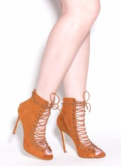 Always stay one step ahead of the trends with these totally timeless lace-up heels. #heels #laceup #booties #hot #shoes #fashion #gojane