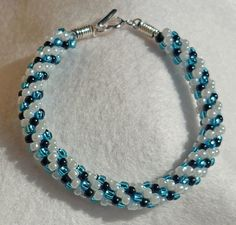 Kumihimo bracelet for the OTTBS May challenge (black, white and turquoise) via Flickr