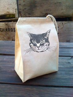 Eco Tabby Cat Lunch Bag with kitty design, Recycled Cotton Canvas Snack sack with rope handle, velcro, and sparkley shimmer ink. $22.00, via Etsy.