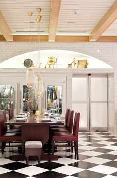 Diners in the Market Room at Restaurant R'evolution can contemplate the view through the glass-fronted curing cabinets, where the house-made charcuterie serves as hanging artwork.  - Sara Essex Bradley