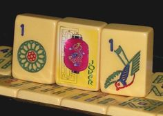 Vintage bakelite mah jongg titles. I have a few of these from my late mother's mah jongg set that I keep in a beautiful Chinese red bowl in my home. When I look at them I go back in time to my mother's Tuesday night mah jongg games with her girlfriends:  endless gossip, strong coffee, and Brach's candy.
