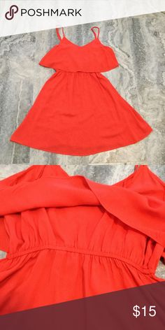 Coral dress Pretty coral dress. Second picture shows the stretch band is has under the chest area. Used in good conditions. Divided Dresses