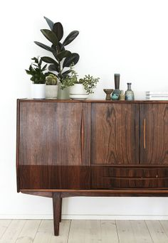 Fresh vignettes on the credenza in Weekday Carnival's home.