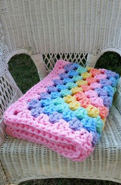 This warm, thick baby blanket with its beautiful repeating rainbow of colors was designed for a dual purpose. Use it as an extra warm blanket, or spread it on the floor as a nice cushy mat for babys play time. Made with four strands of worsted weight yarn, this blanket is thick and warm,