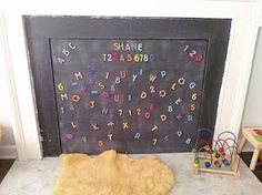 Creative Fireplace Childproofing Using a Magnetic Chalk Board -- I need better quality magnet letters & maybe a second coat of chalkboard paint, but we're digging this so far. Magnetic Paint, Magnetic Chalkboard, Chalkboard Paint, Magnetic Letters, Gyeongju, Suwon, Fireplace Cover, Fireplace Ideas, Unused Fireplace