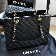 Black and gold leather bag via Luxury store. Click on the image to see more!