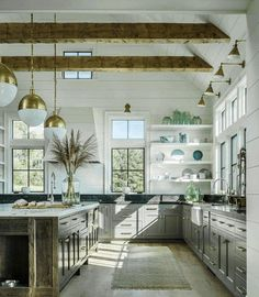Kitchen, Cathedral Ceiling Kitchen White Seat Metal Frame Bar Stools Stone Tile Floor Grey Block Paving Molded Wood Chairs Door Mounted System: Designed for Vaulted Ideas