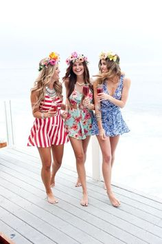 girls-in-sun-dresses-and-flower-crowns-at-beach-house http://itgirlweddings.com/11-essentials-for-your-bachelorette-party-beach-weekend/