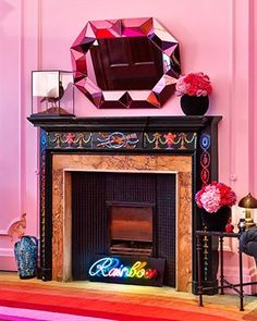The Pink Room. Rainbow painted fireplace by Timna Woollard Studio for Solange Azagury-Partridge's Mayfair Jewellery shop London. image © Solange Azagury-Partridge, solange.co.uk