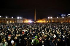 People pack St Peter's Square to await news