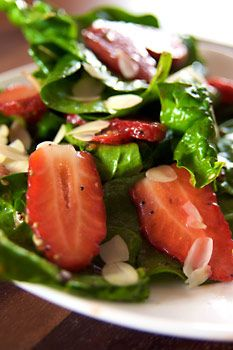 Strawberry and Spinach Salad  Serving Size: 4    Ingredients:        * 10 ounces fresh spinach – rinsed, dried and torn into bite-size pieces      * 1 quart strawberries – cleaned, hulled and sliced      * 1/4 cup almonds, blanched and slivered      * 1 tablespoon sesame seeds      * 1/2 tablespoon poppy seeds      * 1/4 cup sugar      * 1/4 cup olive oil      * 1/8 cup raspberry vinegar      * 1/8 teaspoon paprika      * 1/8 teaspoon soy sauce or tamari      * 1/2 tablespoon onion, minced…