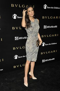 Demi Moore paired her feminine frock with unconventional nude pointy toe wedges.