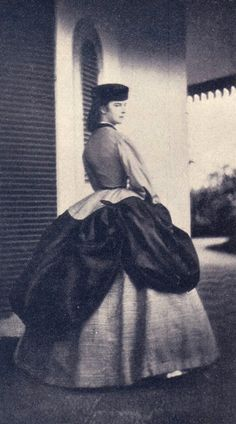 Empress Elisabeth of Austria wearing a polonaise dress This is an interesting photo showing Empress Elisabeth wearing a crinoline worn with a three-lobed polonaise over-skirt.
