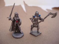 Pewter Warrior man and girl figurines