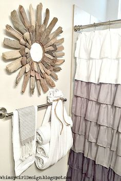 Another simple solution for storing towels: use a large bath towel upside down as a creative holder for additional towels. I used some twine I had at home to secure the towel on the bar and then rolled up the other towels to store inside it. So instead of one towel, there are four that are easily accessible, with extra room for a few hand towels. I love the towel selection at HomeGoods… there are options in every color!