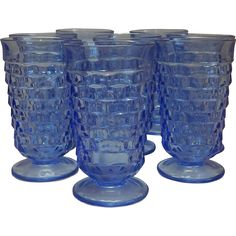 This lovely set of eight blue tumblers in the Whitehall pattern was made by Indiana Glass Company in the 1980's.  Each tumbler is 6 tall by 3-3/8