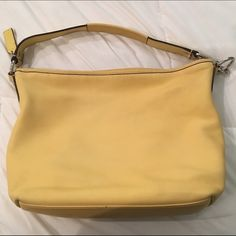 $1 SHIPPING TIL MIDNIGHT SEE DESC✨COACH bag Pre-loved  A Beautiful yellow with brown leather accents. There's a water stain on one side and bottom as pictured.  (Could always wear the other side facing out ;)) Typical wear and tear, it's a light colored bag .  Hardware is silver. 1zipper slot, 2 other slots inside bag. Dimensions, in inches, are about 11H 14L 5W and strap (not including hardware) is about 15inches. Please see additional post for more photos. *As is* Post 1 of 2 ***$1…