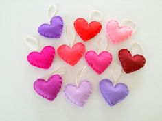 Love is in the air and maybe you are searching for some Valentine heart ornaments. Here are a set of 10 hearts perfect as Valentine decorations. They are made from assorted felt: pink, purple, red, lavender, magenta and they are filled with anti bacterial polyester. You can use the hanging hearts as love sign in a room or in the garden, on the door or on your desk. They could be a great assorted decor for spring time as well or for a party. Each heart is almost 2,75 inches (7cm). The price…