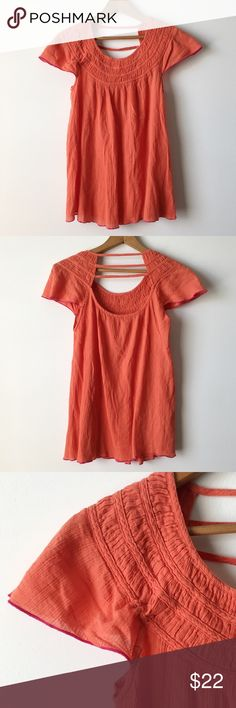 Free People strappy back gauze top Loose & flowy 100% cotton gauze top in a dusty coral color with magenta contrast stitching on sleeve edges, scoop back with strappy detail, from Free People. Smocked detail around neckline. Gently worn, no holes or discolorations. Machine washable. XS but will fit a S fine as well since it's so loose.         Reasonable offers welcome.🎀 No lowballing, please.❌ No trades or non-posh transactions!🚫 Bundle & save!💰 Free People Tops