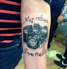 Realist camera tattoo Tattooist: Pierre Moussion